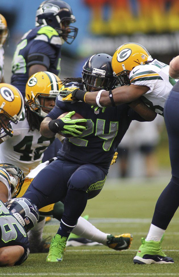 Seattle Seahawks running back Marshawn Lynch (24) runs against the Green Bay Packers during their NFL Monday Night football game at Centurylink Field in Seattle