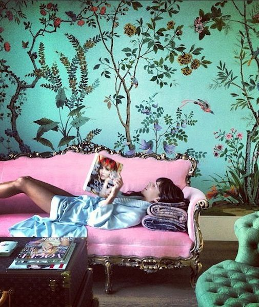 Wallpaper Wishlist. Caroline Sieber baroque pink velveteen sofa in front of a de Gournay fantasy