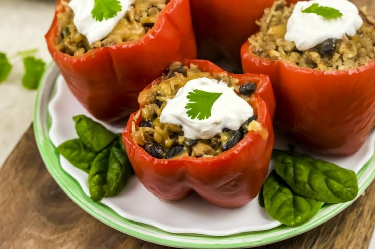 Weight Watchers Slow Cooker Stuffed Peppers are a hearty meal and only 5 Freestyle SmartPoints each. Fix it and forget it in the crock pot is the best way to cook! This Weight Watchers recipe will fill you up and won't use up many Freestyle SmartPoints.