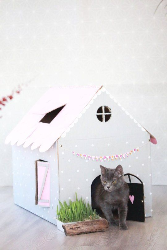 Cat on a Hot Cardboard Roof: DIY Inspiration for Cardboard Cat Houses. More houses at: http://www.apartmenttherapy.com/cardboard-cat-home-215618