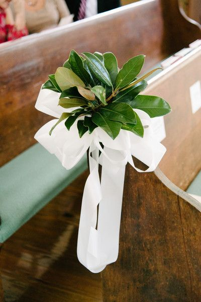 Magnolia leaves + white ribbon wedding ceremony aisle markers {Riverland Studios}