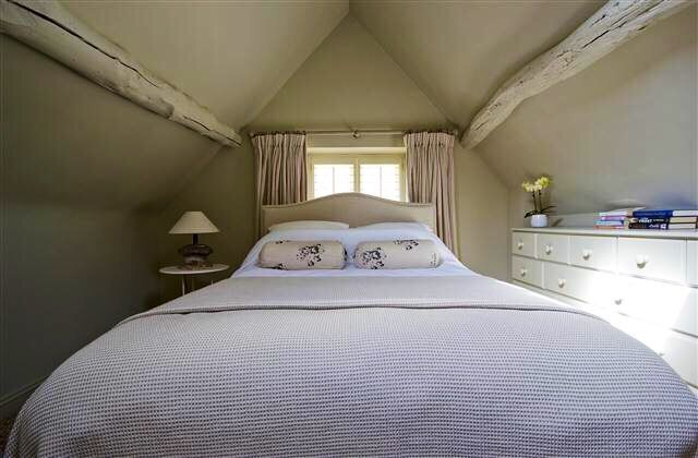 Pretty vaulted bedroom.