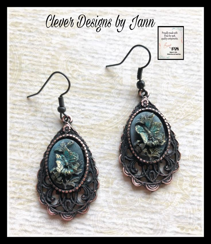 B'sue by 1928 components are used in these earrings .. Butterfly cabs are painted to look distressed for that vintage look .. Clever Designs by Jann ..