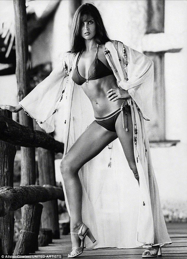 Caroline Munro in her obligatory bikini, with a stylish kimono and dancer shoes...