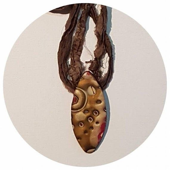 Polymer clay necklaces all individually crafted by hand in Western Australia.  Clay pendant on raw silk. Length approx 35cm. This ethnic inspired pendant bronze and red in colour and is made using the mukame gane technique. NB. All of my pieces are handmade, orders are shipped 5-10 business days from date of your order. If you need your order for a special occasion, please allow enough time to have it made.  Custom orders are more than welcome. For more information, please email…
