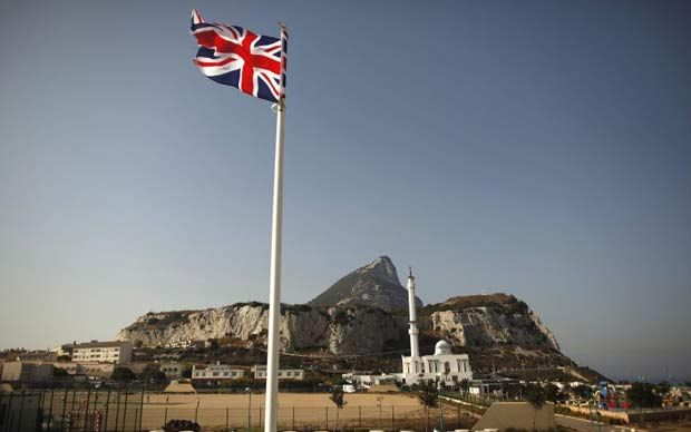 A Union flag flies in front of the Rock of Gibraltar, a British Overseas Territory.