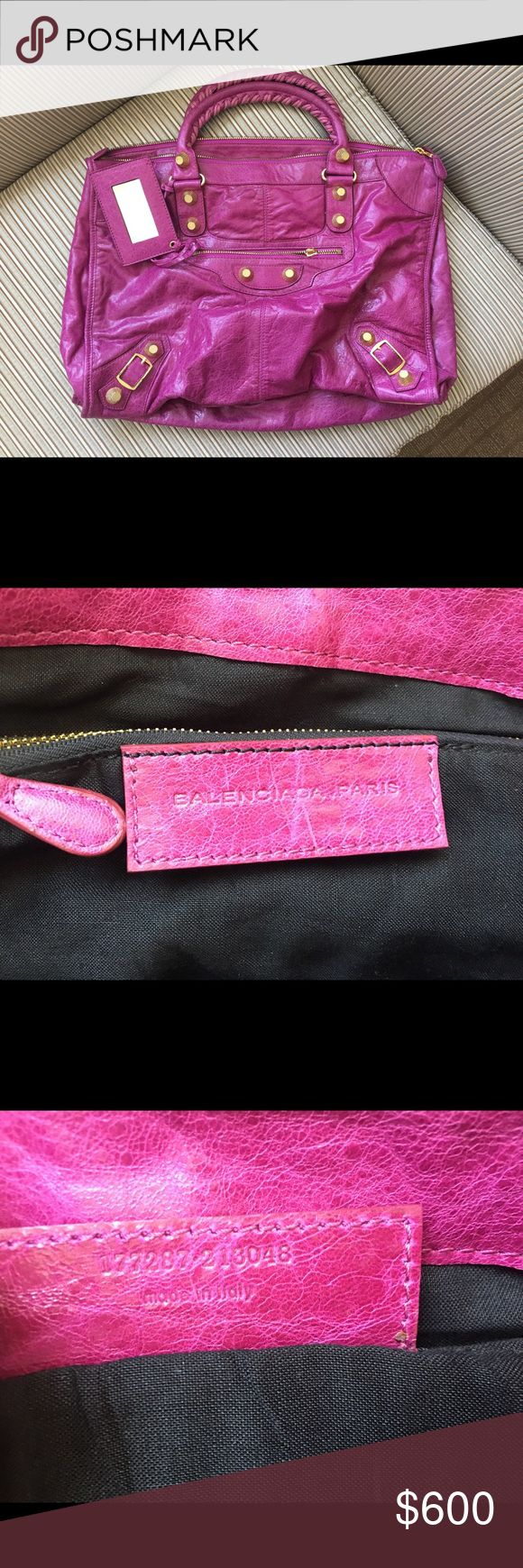Balenciaga Work Magenta GGH Used a few times. In overall great condition. Comes with mirror, no dust bags. Purchased from consignment store in Newport Beach. Front zipper pull missing! Price adjusted accordingly. Please send me any reasonable offers. Balenciaga Bags Shoulder Bags