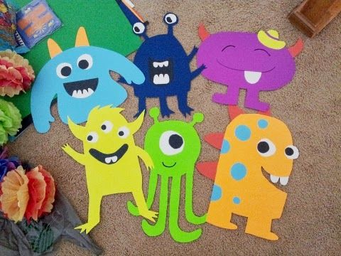 Poster board monster party decorations and DIY tissue paper pom-poms