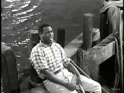 """Ol' Man River"" (Show Boat, 1936),     now  utterly non PC,  was a great musical masterpiece that shocked America in its sympathetic portrayal of black suffering.....the great Paul Robeson at his best"