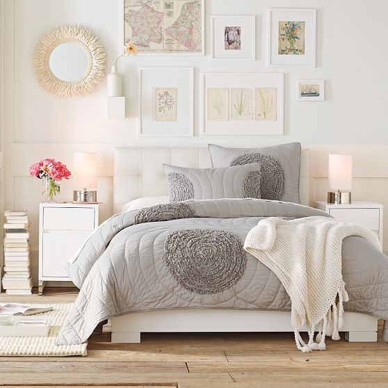 There is something of vintage in this white #bedroom. I like the pics on the wall!