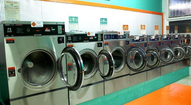 A long line of front loader washing machines ready to be