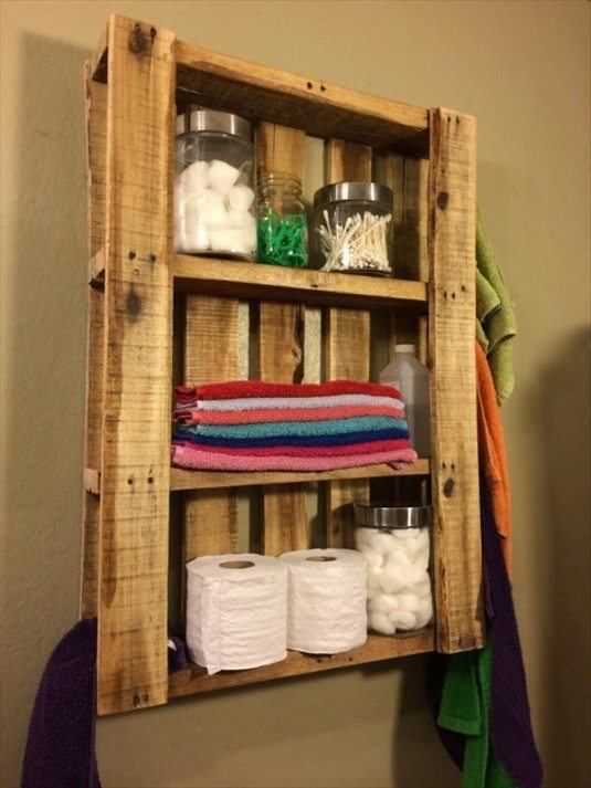 Pallet wall hanging storage  We all know that the pallets are now in trend for decorating your home. In the photo down, we can see amazing pallet used like a storage cabinet in the bathroom. You can make extra shelves or paint in different color to make more comfortable look.