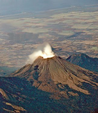 Nicaragua's San Cristobal Volcano. Volcán San Cristóbal is the highest volcano in Nicaragua at 1,745 m. Located near to the northwest corner of the country, it forms a majestic backdrop to the city of Chichigalpa, Chinandega. (V)