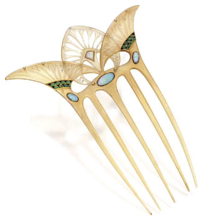 George Fouquet made this hair adornment between 1905 and 1908. The materials are clearly Art Nouveau, carved tortoiseshell, enamel and opals. The design, however hints towards the egyptian Art Deco trend that would come a few years after it was made.