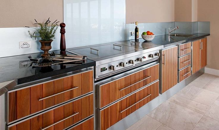Stainless Steel Outdoor Kitchen Cabinets - https://www.interiorhd.com/kitchen/stainless-steel-outdoor-kitchen-cabinets/  Outdoor kitchen cabinets are constructed using durable materials like stone, stainless steel, and redwood. This protects them from the harmful effects of seasonal weather and termites. They can be as simple as one cabinet next to a gas or charcoal grill, to a full set of cabinets complete with a...