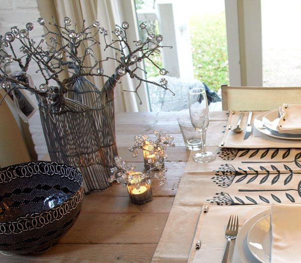 www.south-design.nl - gorgeous x-mas table - handmade - place mats with bone details - baobab wire art - - bowls made of recycled paper- empowerment - fair trade - art of giving