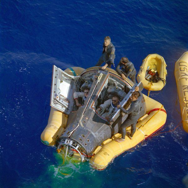 Neil Armstrong and David Scott looking cool while their Gemini 8 Capsule is being recovered, 1966.