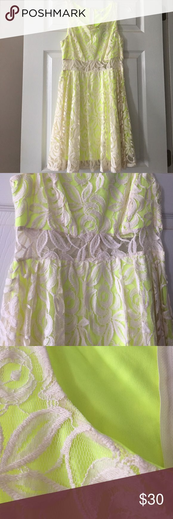 Neon & Lace Dress Super adorable neon green dress with creme lace overlay and a sheer mid section! Brand new still has the tags attached! love, Fire Dresses