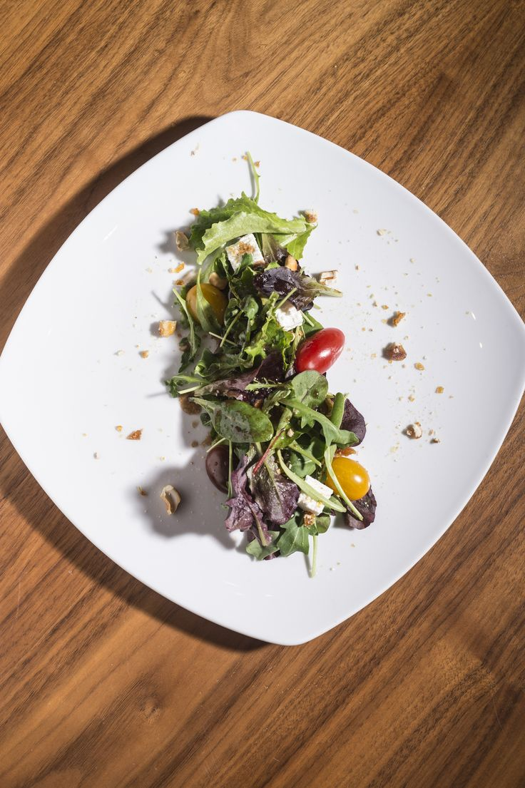 Mixed tender greens with anthotiro cheese, cherry tomatoes, caramelized cashews & pomegranate vinaigrette. #anatoliagastronomy