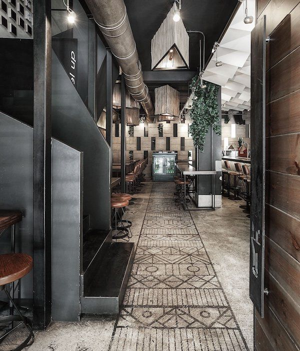 An industrial interior at Cheval lounge bar in Thessaloniki