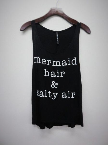 If you're really a mermaid, you need this tee. Mermaid hair and salty air is your motto. Black with white lettering. Doubles as a cute swim coverup!