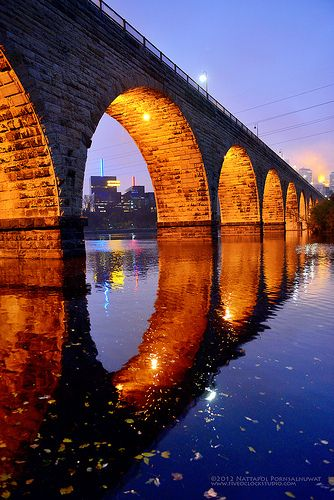 Beautiful gold light of sunrise on the arches of this bridge of brick reflect in the still blue waters to create CIRCLES. - DdO:) - http://www.pinterest.com/DianaDeeOsborne/dido-reflections/ - DiDoReflections;com free music website with songs Reflecting God's promises of help, comfort. Nice photo pinned via Picked For You. NOTICE GREAT COMPOSITION: One opening is a FRAME for the city buildings on distant skyline.