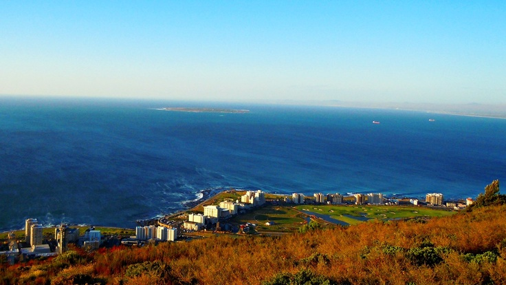 Three Anchor Bay - Taken from the top of Signal Hill looking out towards the Atlantic Ocean over Three Anchor Bay and Mouille Point One can just see Robben Island in the background.