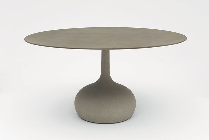 buratti architetti explores concrete in saen table for alias
