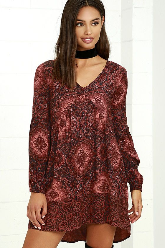 Let your love for the Billabong Clearest Melody Rust Red Print Babydoll Dress ring loud and clear! Charcoal grey, rust red, and burgundy print swirls across this woven babydoll dress with a soft V-neckline, billowing long sleeves (with elastic cuffs), and a fluttering skirt with a slight high-low hem. Metal logo tag at back.