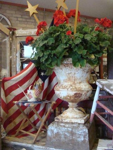 Weathered urn, red geraniums, stars,  and the US flag...Perfect!