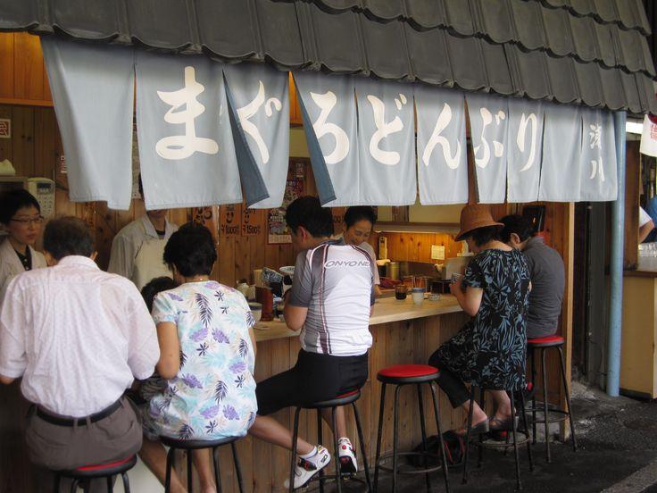 Tokyo Sushi Fish Market Stall - http://johnrieber.com/2014/10/09/tokyo-a-love-story-colorful-cosplay-bikini-robots-breakfast-sushi/
