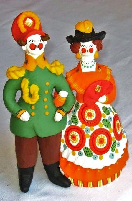 Dymkovo toy is a traditional painted clay toy from the Russian village of Dymkovo. An officer with a lady. #Russian #folk #art