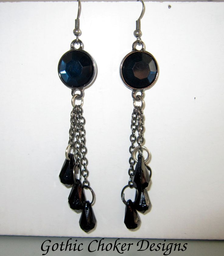Dark blue stone earrings with three black crystals hanging from chains.  R100