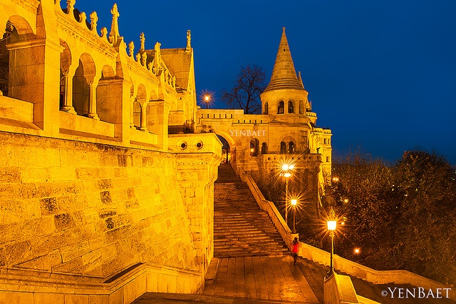 Budapest, Hungary - Twilight at Halászbástya | Fisherman's Bastion - Photo © www.YenBaet.com. The Halászbástya or Fisherman's Bastion is a terrace in neo-Gothic and neo-Romanesque style situated on the Buda bank of the Danube, on the Castle hill in Budapest. It was designed and built between 1895 and 1902 on the plans of Frigyes Schulek. The Bastion takes its name from the guild of fishermen that was responsible for defending this stretch of the city walls in the Middle Ages.