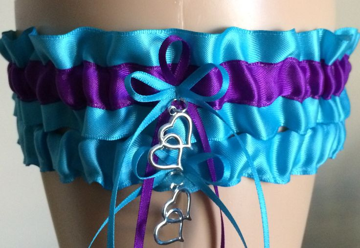 Simple, yet elegant Turquoise and Purple Garter Set with a silver charm and matching bow! Available Size: This garter comes in a regular and plus size! All garters are made to order and can be altered