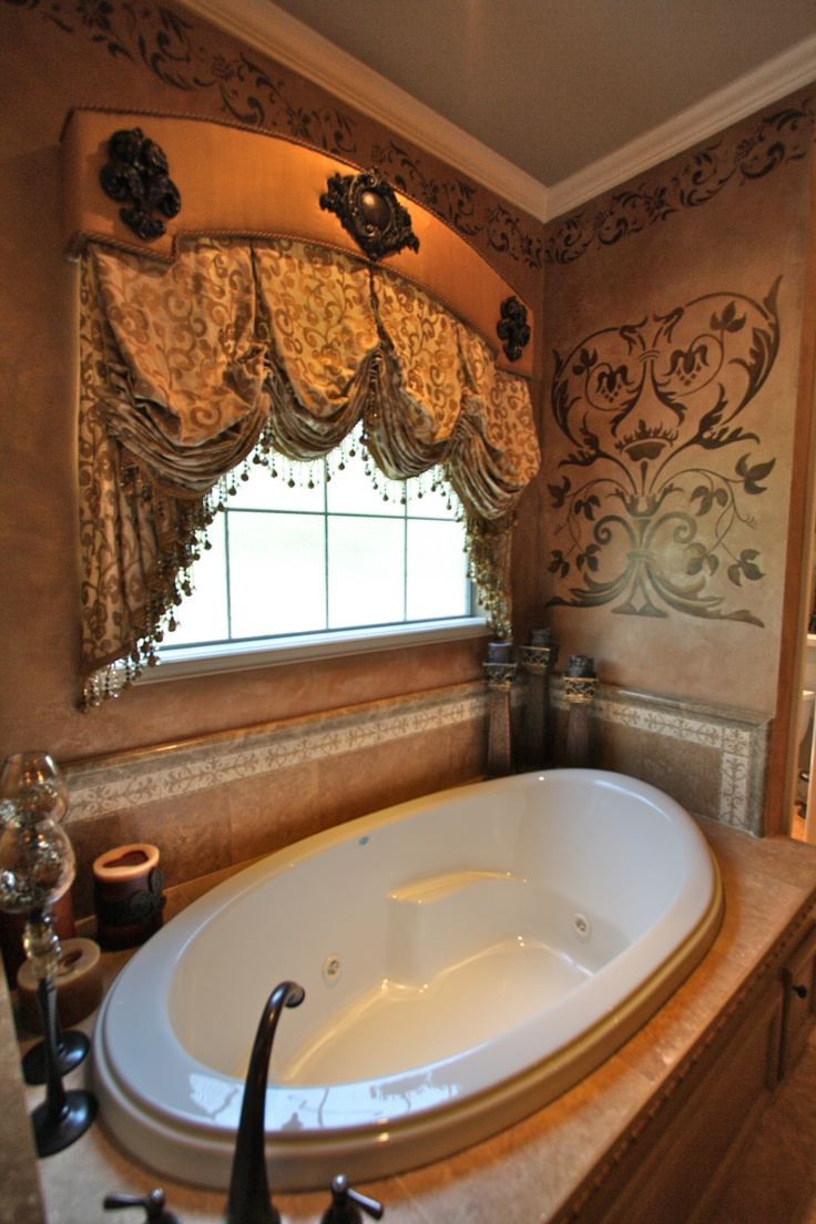 This master bath was transformed with this window treatment and faux painting.