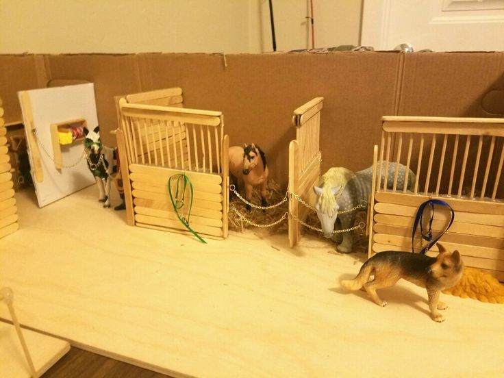 The buckskin is back in her stall. Added some last minute details to the schleich popsicle stick stable including bedding, stall hangers, feeders, and water buckets