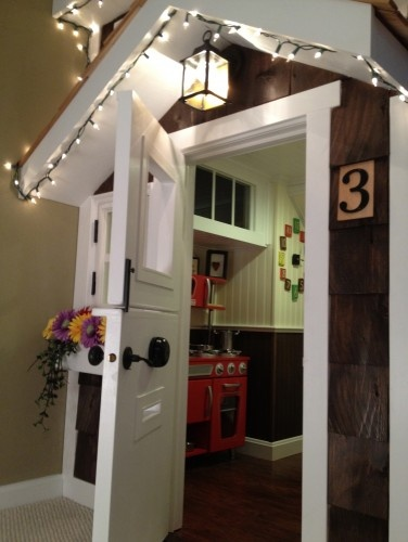 Built in playhouse in game room (put kitchen inside) so cute!