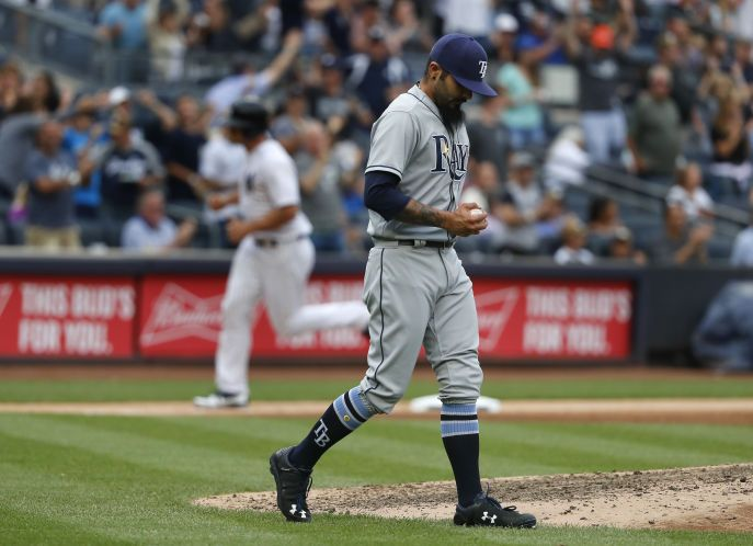 Tampa Bay Rays relief pitcher Sergio Romo reacts after giving up a two-run home run to the New York Yankees during the sixth inning of a baseball game, Saturday, July 29, 2017, in New York. (AP Photo/Julie Jacobson) NYJJ118