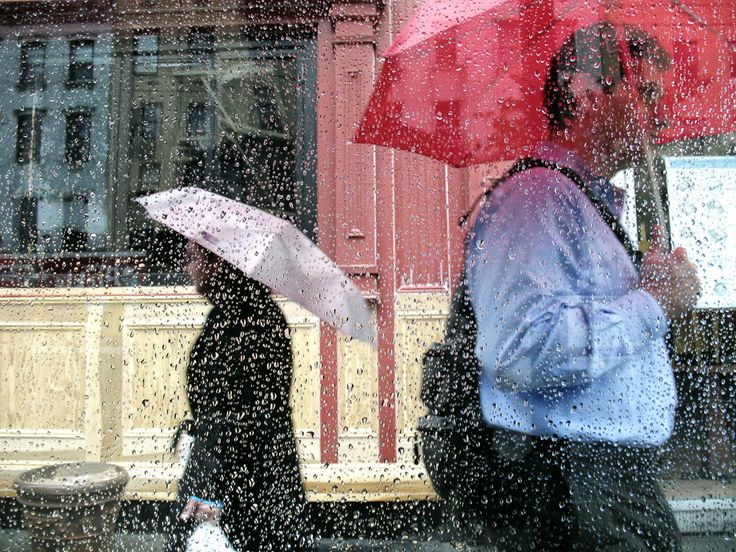 Two Figures in Rain (color) | NEW YORK CITY PHOTOGRAPHY | Through bus stop glass - focus on beads... by Dave Beckerman