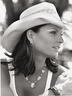 "Terri Clark (born on August 5, 1968 in Montreal, Quebec, Canada) is a country musician. She grew up in Medicine Hat, Alberta and moved to Nashville at age 18. There she played at Tootsie's Orchid Lounge, where she got her start. She signed with Mercury Records, and her first single, ""Better Things to Do,"" reached No. 3. Clark was the first Canadian woman to be inducted into the Grand Ole Opry on June 12, 2004."