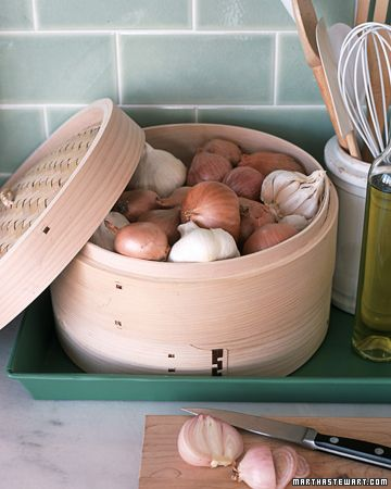 Steamer Storage:  Bamboo steamers have holes that let air in and out to cook food uniformly. For just that reason, these containers are also well suited to storing onions, garlic, and shallots, which require ventilation and should not be refrigerated. Place all three in a single unit, or if you use lots of all of them, keep each kind in its own section of a stackable steamer. Place the steamer on a tray or plate to catch flaking skins, and set it on the counter for quick accessBamboo Steamer, Garlic, Stores Onions, Food, Kitchens Cleaning Tips, Storage Bins, Martha Stewart, Storage Ideas, Kitchens Storage