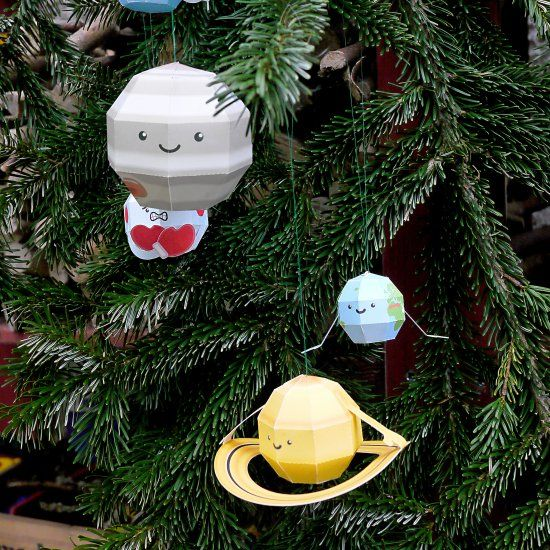 Festive baubles representing our solar system's eight planets (plus Pluto and the sun). Free downloadable PDF template.
