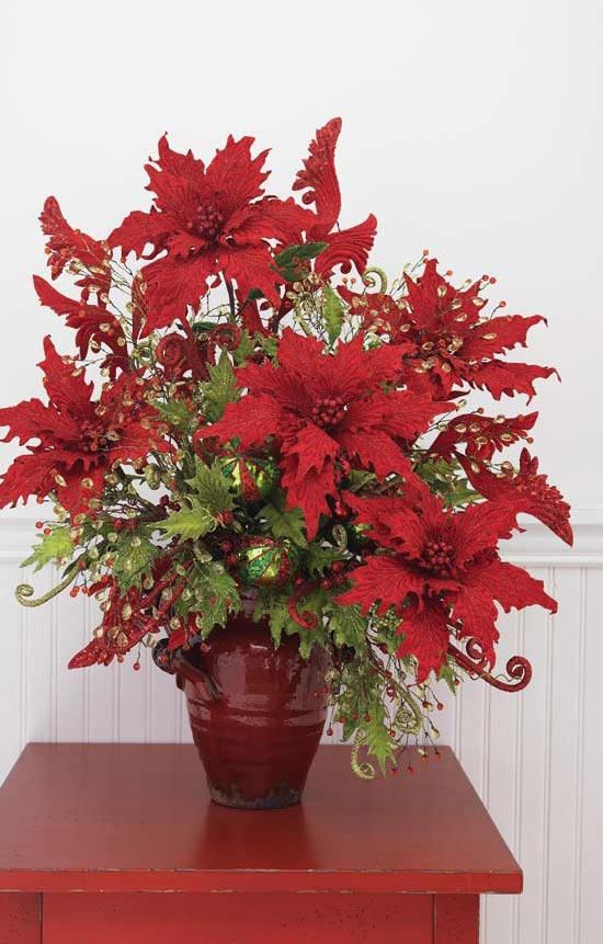 Red poinsettia with jewel and holly ball ornamnet sprays