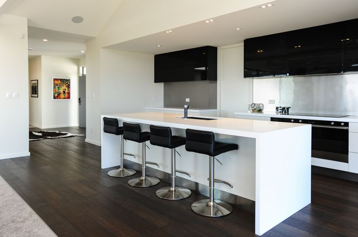 Kitchen tops are Pure white ceasarstone 50mm thick. While the joinery is painted in two pot lacquer Wattyl ¼ dreamtime and Resene black jack