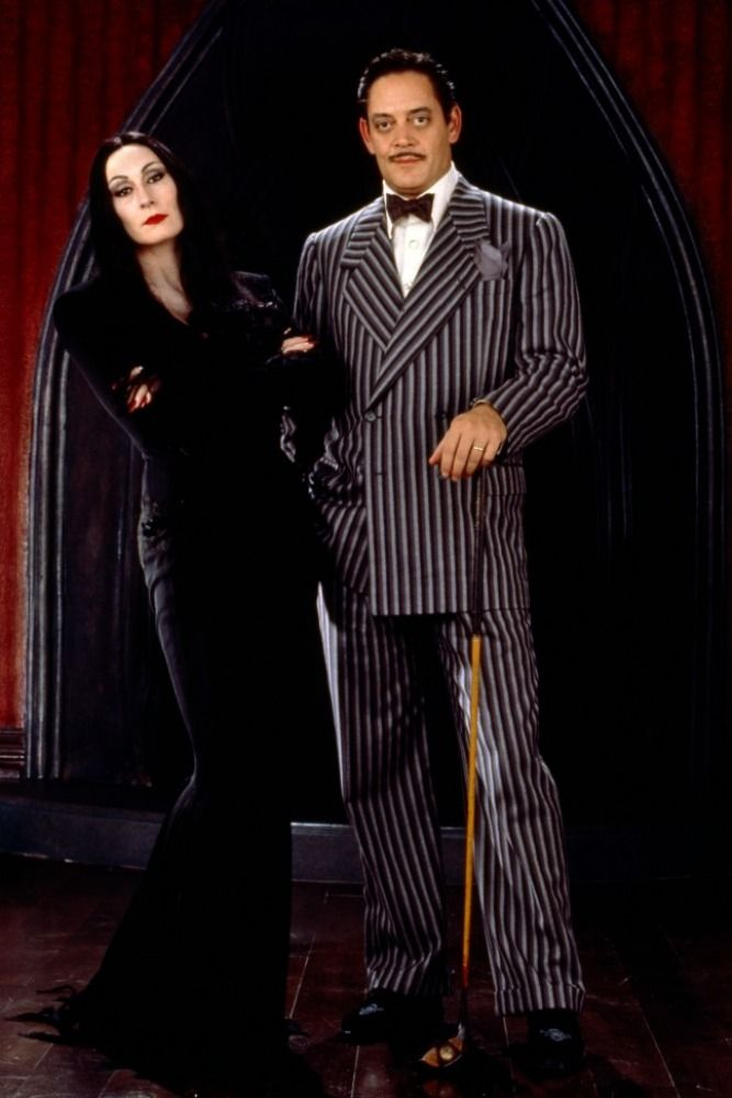 Raul Julia and Anjelica Huston in The Addams Family (1991)  there chemistry together was amazing and addictive.