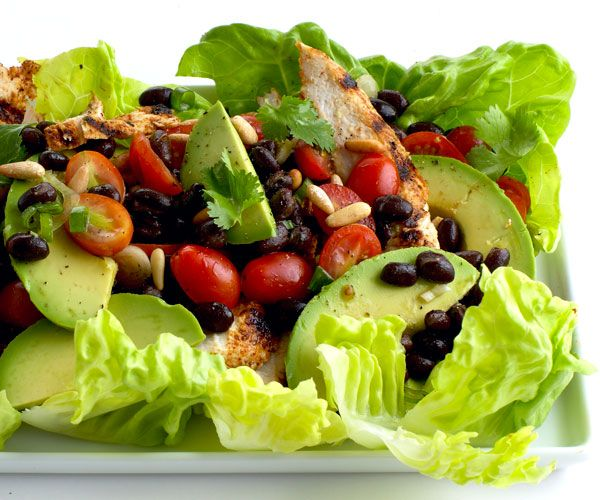 Southwestern Grilled Chicken Salad with Tomato and Black Bean Salsa (Grilled Chicken, Romaine, Halved Grape Tomatoes, Black Beans, Avocado, Corn, Pumpkin Seeds, Spicy Dressing)