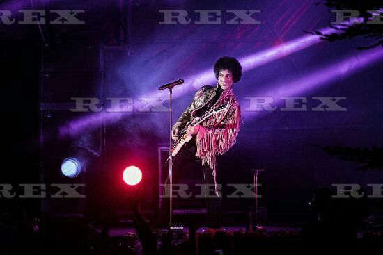 American music icon Prince is having a good time on stage and smiles to the listeners at Skanderborg Festival in Denmark. Denmark 2013. 7 Aug 2013