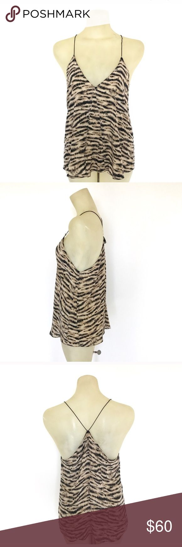 Reformation silk animal print cami Reformation silk animal print cami. This piece is from one of her first collection! It's gorgeous! Reformation Tops
