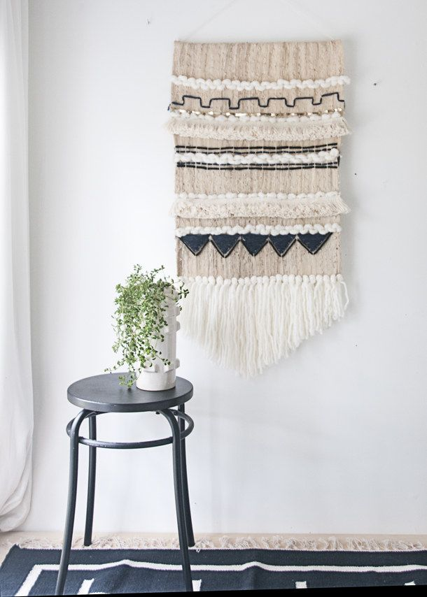 Craft a woven wall hanging to cover up wall dings in a rental or until you can repaint.